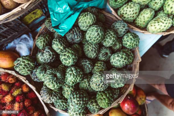baskets with sugar apple fruits in brazil