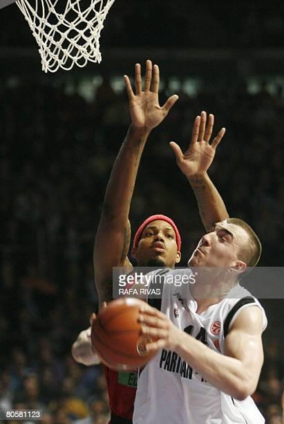 TAU Baskonia's Will McDonald vies with Partizan Igokea's Nikola Pekovic during their Play Off third leg Euroleague Basket match at the Fernando Buesa...
