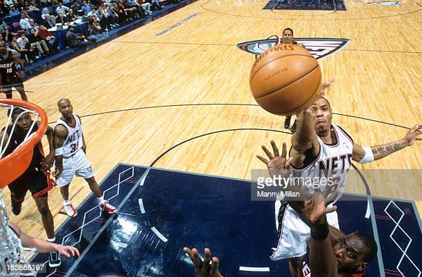 New Jersey Nets Kenyon Martin in action defense vs Miami Heat Anthony Mason at Continental Airlines Arena East Rutherford NJ CREDIT Manny Millan