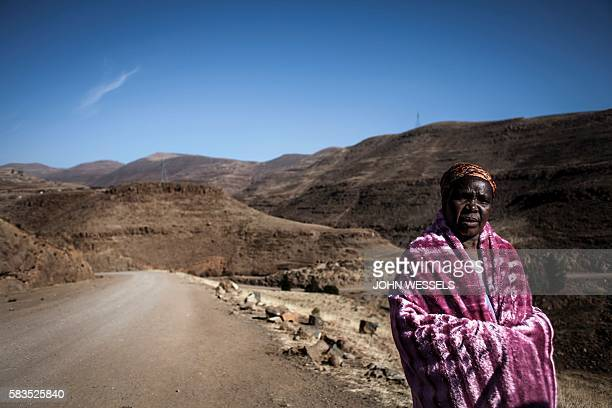 Basotho woman walks her way for 20 km to a World Food Program's food distribution station on July 13, 2016 in Katse. Farmers in Lesotho have been...
