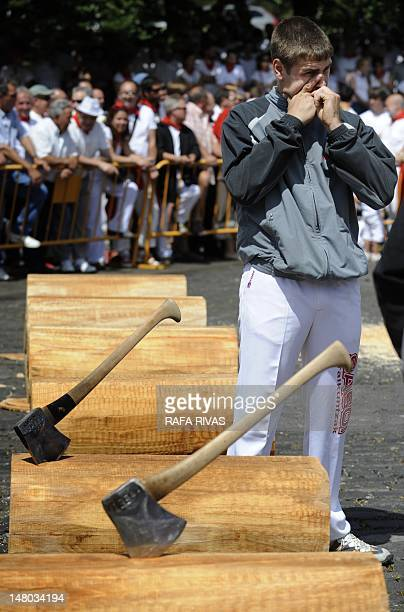 A Basque aizkolari prepares to chop tree trunks during a rural Basque sports championship on July 8 during San Fermin Festival in the Northern...