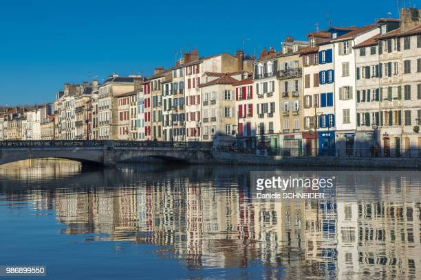 basque country, bayonne, petit bayonne district, quay galuperie, facades reflecting in the nive river - aquitaine stock photos and pictures