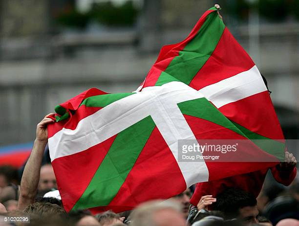 Basque cycling fans wave their flag in support of the Euskaltel Euskadi team during the presentation of teams on the eve of the commencement of the...