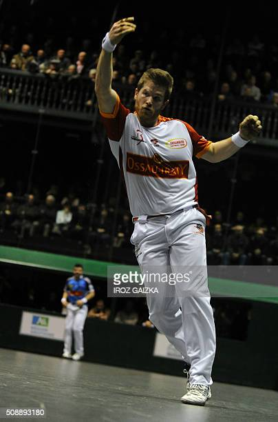 Basque pelota champions Peio Larralde and Baptiste Ducassou compete against each other during the final of the Hand Pelota French Championships on...