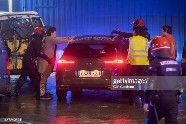 Basque police officers identify some basque protesters who participated on blocking the border between France and Spain with a slow march of vehicles...