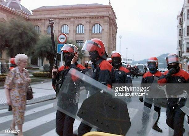 Basque policemen patrol a street of the San Sebastian parte vieja 15 July one day after the funeral of Miguel Angel Blanco who was assassinated by...