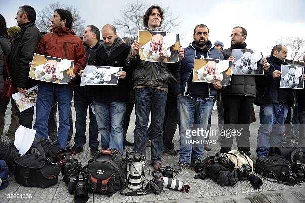 Basque press photographers protest in front of the Basque regional police Ertzaintza headquarters in the Northern Spanish Basque town of Durango on...