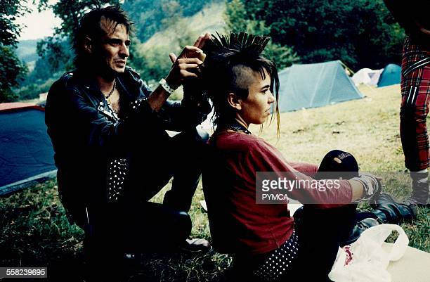 Basque punks at a camp site styling hair 1990s