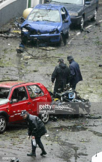 Basque regional policemen inspect the area where a car bomb exploded 18 January 2005 at Getxo in the Basque country with armed Basque separatist...