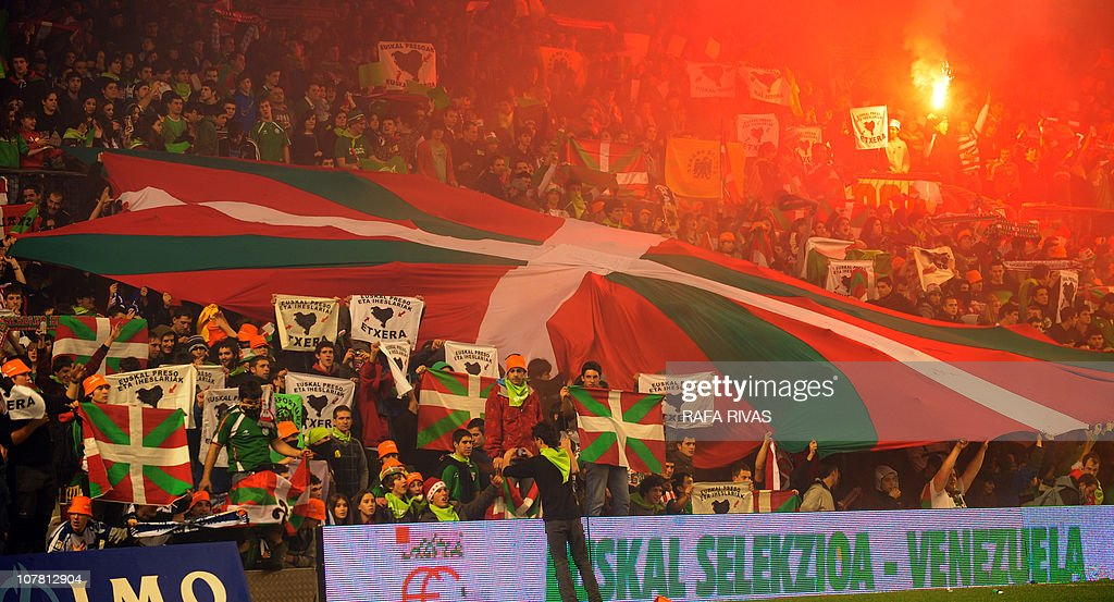Basque selection team's supporters unfold an Ikurrina (Basque flag) during a friendly football match against Venezuela at the San Mames stadium, in the Northern Spanish Basque city of Bilbao, on December 29, 2010. Basque selection team won 3-0.
