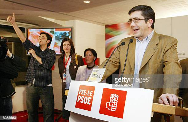 Basque Socialist Party General Secretary Patxi Lopez addresses supporters while PSOE executive member Eduardo Madina who lost a leg after...