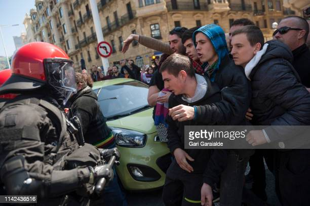 Basques antifascist supporters clash with riot police outside of a meeting of Santiago Abascal leader of Spanish farright party Vox during General...