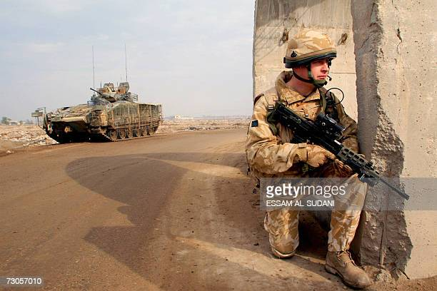 British soldier secures the area at the site where a roadside bomb targeted their patrol in the southern city of Basra, 21 January 2007. The roadside...