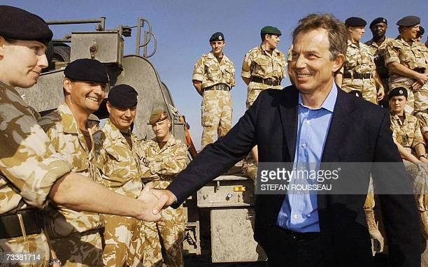British Prime Minister Tony Blair meets troops as he arrives in Basra for a visit to British soldiers in Iraq, 04 January 2004. Blair announced...
