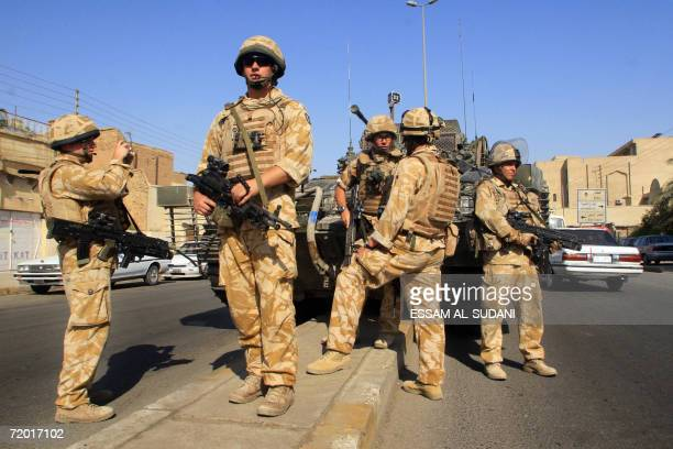 British soldiers patrol a street in the southern city of Basra 27 September 2006. British troops poured today into eastern Basra as part of Operation...