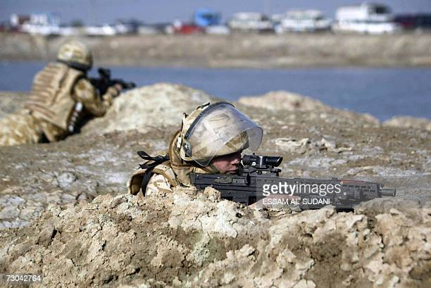British soldiers take combat position as they patrol an area on the outskirts of the southern city of Basra, 19 January 2007. Six British soldiers...