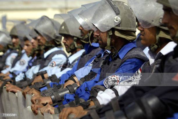 Iraqi police line up in formation as they take part in riot control training in the southern port city of Basra, 550 kms south of Baghdad, 01...