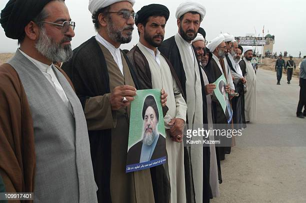 Iraqi Shia clergyman and followers of Ayatollah Mohammad Baqer Hakim, wait for him at the crossing of Iran-Iraq border, after years of exile, 10th...