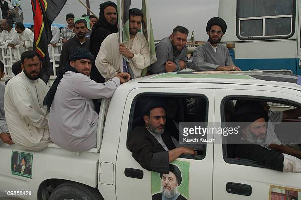 Shia clergymen and followers of Ayatollah Mohammad Baqer Hakim, escort him to Basra, after years of exile in Iran, 10th May 2003. He decided to...