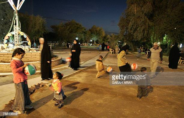 TO GO WITH AFP STORY IN ARABIC BY SABAH ARAR Iraqi Shiite Muslims play at a theme park in the southern city of Basra 04 March 2007 Iraqis residing in...