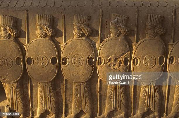 Basrelief depicting Persian guards in ruins of Persepolis or Takhte Jamshid near Shiraz Iran