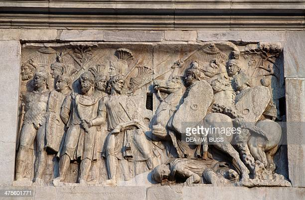 Basrelief depicting the Roman cavalry charge commanded by the Emperor Trajan himself against the barbarians who are retreating Arch of Constantine...