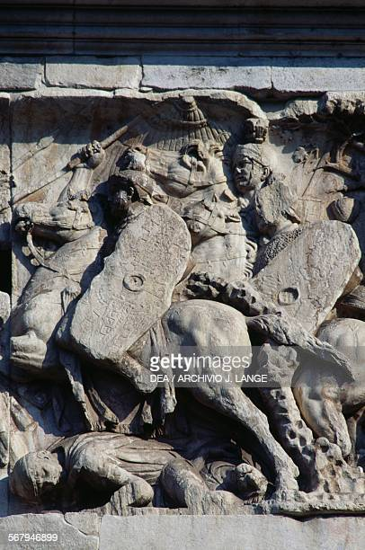 Basrelief depicting the Roman cavalry charge commanded by the Emperor Trajan against the barbarians who are retreating detail Arch of Constantine 315...