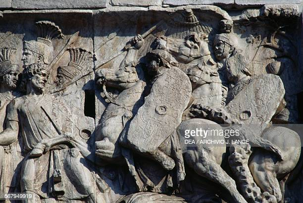 Basrelief depicting the Roman cavalry charge commanded by the Emperor Trajan against the barbarians who are retreating Arch of Constantine 315 AD...