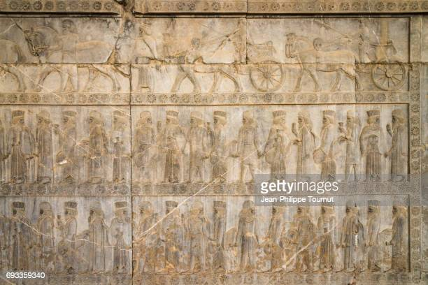 a bas-relief depiction of united medes and persians at the apadana in persepolis, shiraz, fars province, iran - mesopotamian art stock photos and pictures