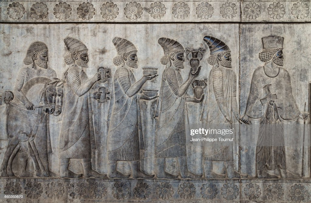 Bas-relief from the Apadana depicting Armenians bringing their famous wine to the king,  Ancient City of Persepolis, Shiraz, Fars Province, Iran : Stock Photo