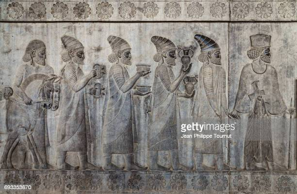 bas-relief from the apadana depicting armenians bringing their famous wine to the king,  ancient city of persepolis, shiraz, fars province, iran - persian stock photos and pictures
