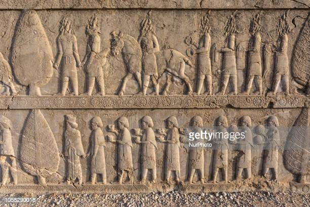 Bas-relief from the Apadana depicting subordinate peoples bringing goods to the king in remains of Persepolis, the ceremonial capital of ancient...