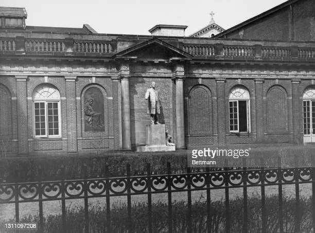 Bas-relief of Abraham Lincoln and a statue of the first pastor of Plymouth Church, Henry Ward Beecher, both by American sculptor Gutzon Borglum, in...
