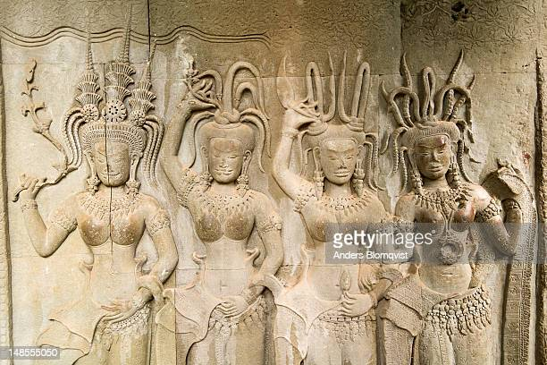 bas-relief of four apsaras (heavenly maidens) with elaborate hairstyles at angkor wat. - classical mythology character stock photos and pictures