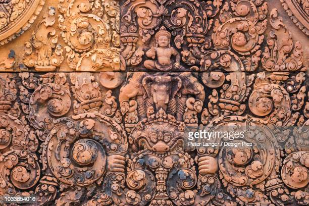 bas-relief of indra riding the three-head elephant airavata on a pediment of banteay srei - banteay srei stockfoto's en -beelden