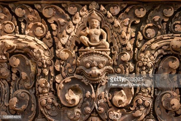 bas-relief of shiva mounted on kala in banteay srei - banteay srei stockfoto's en -beelden