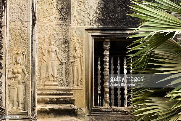 bas-relief of three apsaras (heavenly maidens) on wall of great porch of outer wall at angkor wat. - classical mythology character stock photos and pictures