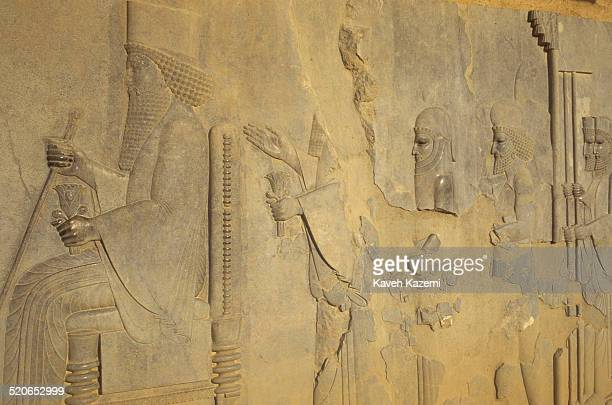 Bas-relief on the staircase of Apadana palace in the ruins of Persepolis or Takht-e Jamshid near Shiraz, Iran.