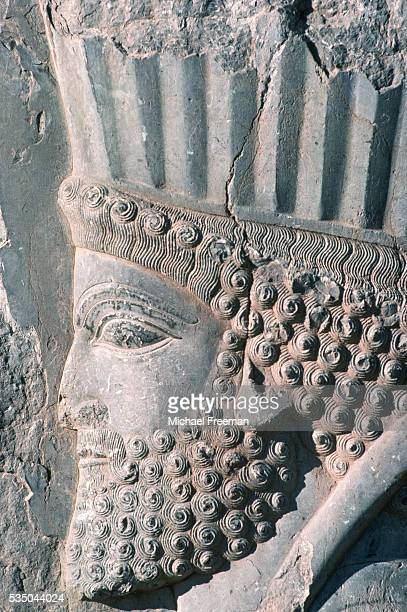 A basrelief sculpture of the head of Darius I adorns the south terrace staircase at the ancient city of Persepolis