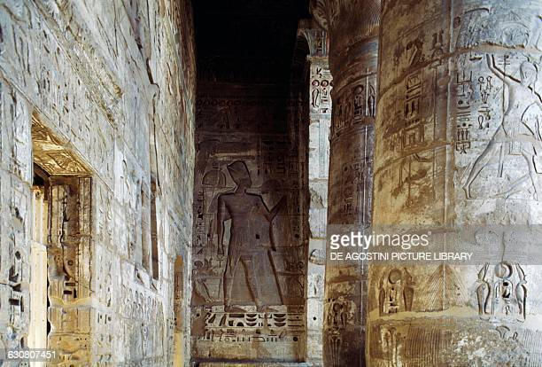 Basreliefs on the columns and the pillars of the portico courtyard of the Mortuary Temple of Ramesses III Medinet Habu Thebes Egyptian civilisation...