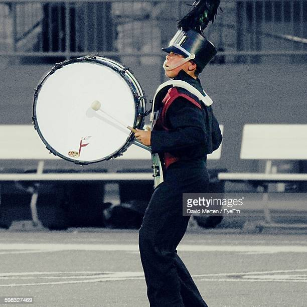 bass drum player in marching band - marching band stock pictures, royalty-free photos & images