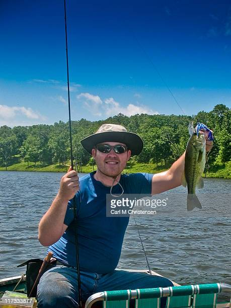 bass fisherman shows his fish - columbia missouri stock pictures, royalty-free photos & images