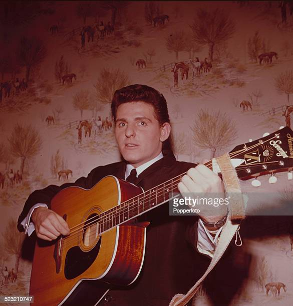 Bass guitarist and singer Tony Jackson from Merseybeat group The Searchers posed with an acoustic guitar backstage during a recording of the...
