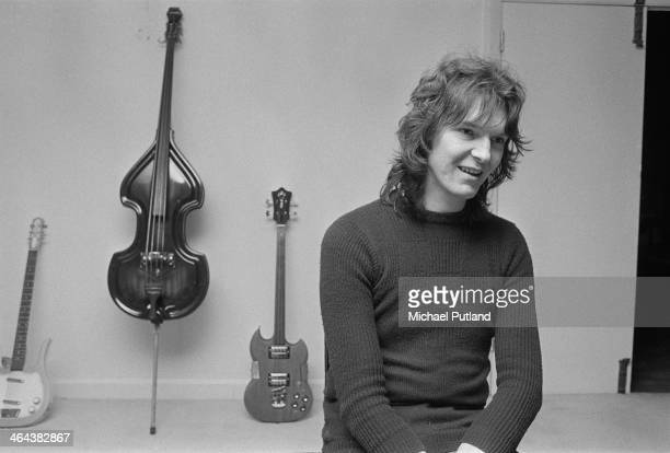 Bass guitarist Chris Squire of English progressive rock group Yes 10th January 1974 Behind him are two electric guitars and an upright electric bass