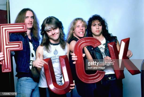 Bass guitarist Cliff Burton drummer Lars Ulrich vocals guitarist James Hetfield and guitarist Kirk Hammett pose for a studio portrait during the Ride...