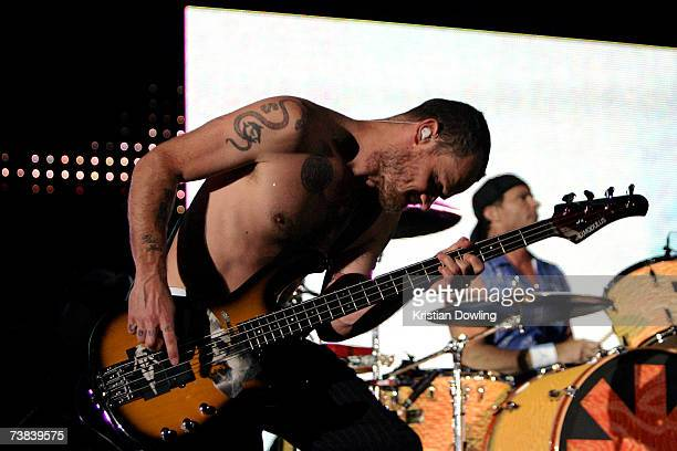 Bass guitarist Flea and drummer Chad Smith of the Red Hot Chili Peppers perform on stage in concert on the first night of their Australian tour at...