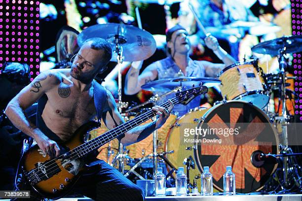 Bass guitarist Flea and drummer Chad Smith of the Red Hot Chilli Peppers perform on stage in concert on the first night of their Australian tour at...