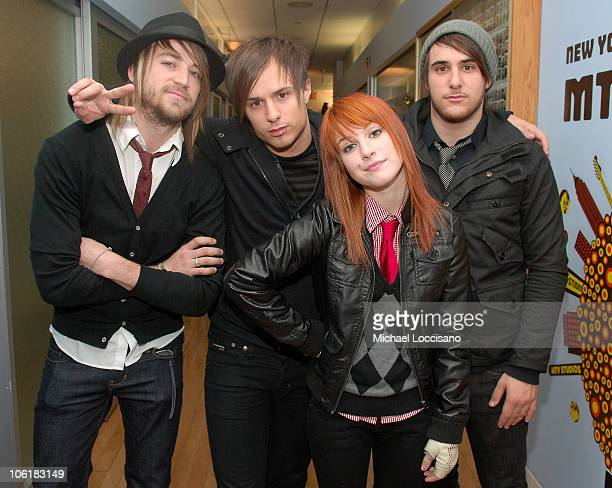 Bass guitarist Jeremy Davis guitarist Josh Farro singer Hayley Williams and drummer Zac Farro of Paramore appear on MTV's 'TRL' at MTV Studios in New...