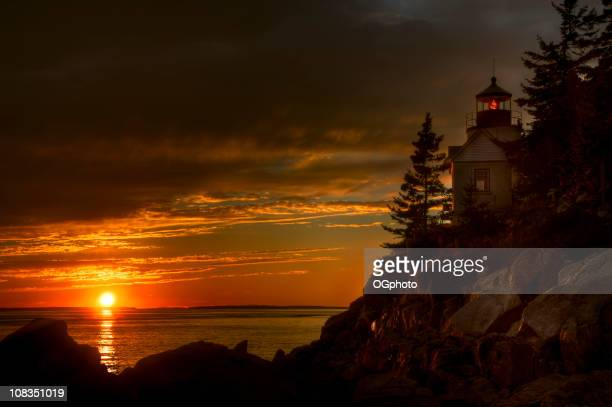 bass harbor lighthouse at sunset - ogphoto stock photos and pictures
