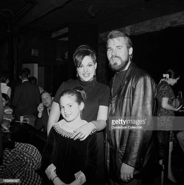 Bass player and singer Kenny Rogers of the rock and roll band The First Edition perform at the Bitter End night club on November 8 1967 in New York...